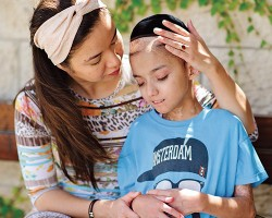 Uriel Wang receives comforting words from his mother, after being driven to Hadassah Ein-Kerem Hospital by an ICSN volunteer.