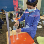 Yeshivat Noam Sixth Grade Scientists Displace Water While Measuring Volume