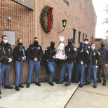 Ahavath Torah and East Hill Synagogue Deliver New Year's Baskets to Englewood Police